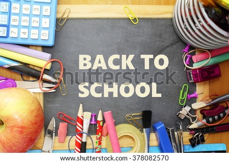 school supply on small blackboard with back to school words - stock photo