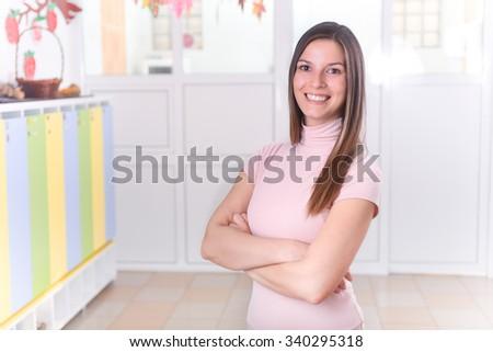 School Teacher Standing in Hall - stock photo