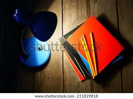 School tools and the fixture. On a wooden background. - stock photo