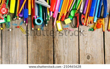 School tools. On a wooden background. - stock photo