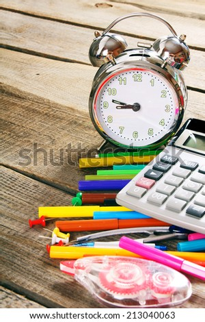 School tools. On a wooden background.