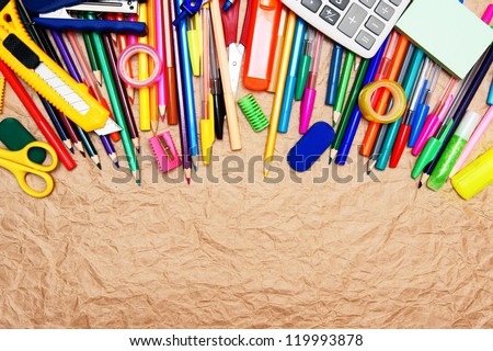 School tools on rumpled paper. - stock photo