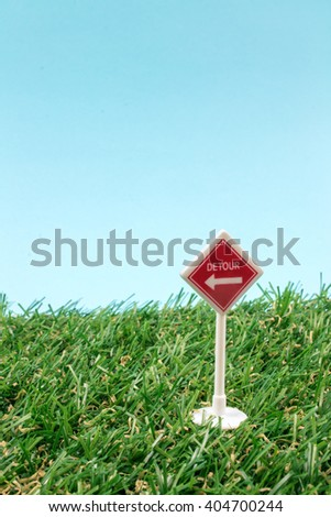 School Toy Sign on Green Grass.