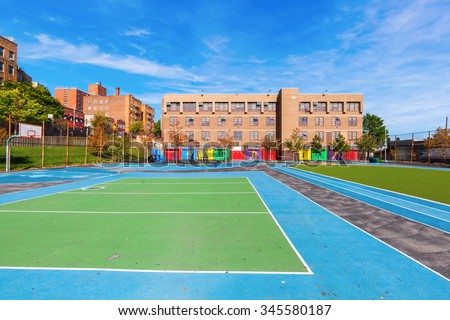 school with playing field in the Bronx, New York City