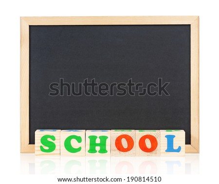 School word formed by wood alphabet blocks with small blackboard, isolated on white background - stock photo
