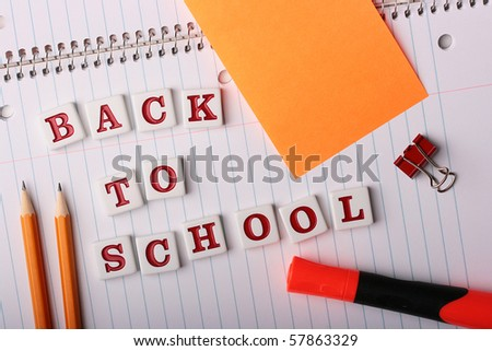 School writing-book with text Back to School and school subjects.