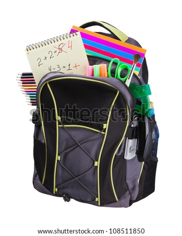 schoolbag with supplies for education - stock photo