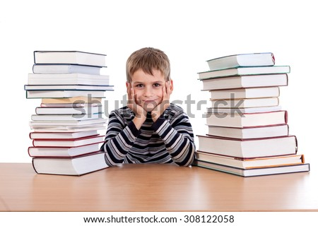 Schoolboy and a heap of books isolated on a white background
