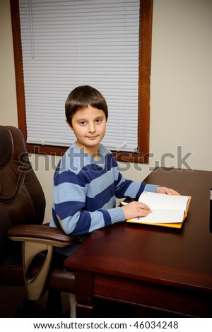 Schoolboy at the desk - stock photo