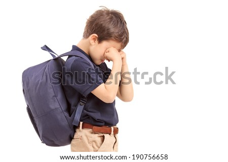 Schoolboy crying, isolated on white background - stock photo