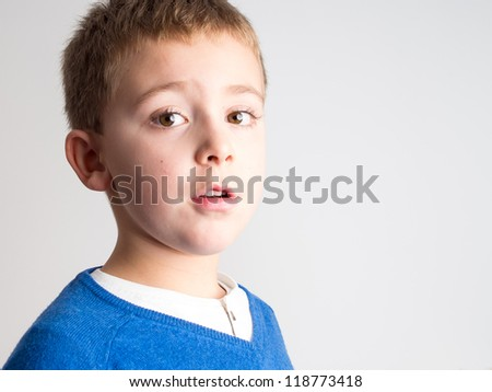 Schoolboy facial expression - Portrait of a child - stock photo