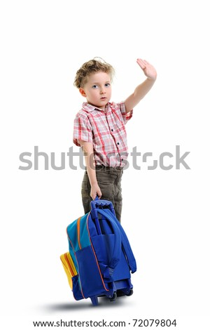 schoolboy holding his backpack and waving while going to school