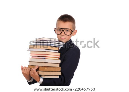 Schoolboy holding huge stack of books  isolated over white background