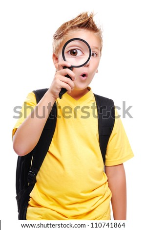 Schoolboy holding the magnifying glass isolated on white - stock photo