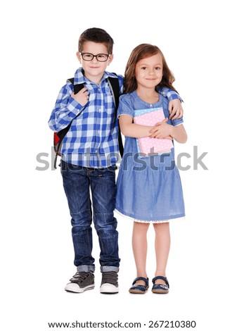 schoolboy hugging the schoolgirl  full length portrait on white - stock photo