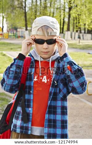 schoolboy in sunglasses - stock photo