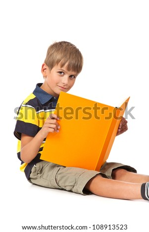 Schoolboy is holding a book isolated on a white background