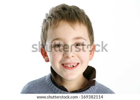 Schoolboy making faces - stock photo