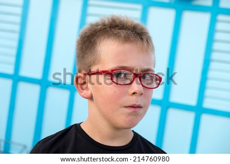 Schoolboy Outdoor portrait with seaside changing-room on background - stock photo