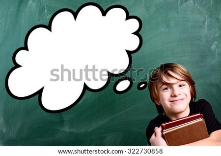 schoolboy over empty school green chalkboard with strip cartoon - stock photo