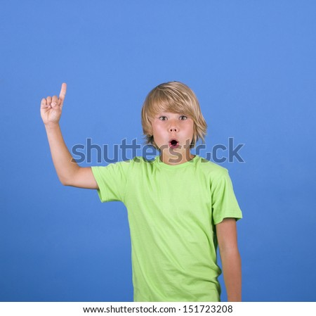 schoolboy raising his hand to give an answer - stock photo