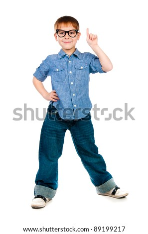 schoolboy raising his hand to give an answer - isolated on white