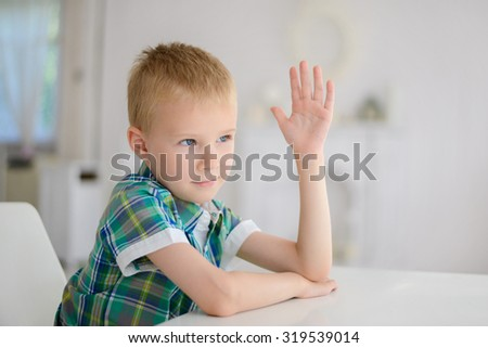 Schoolboy ready to answer question . - stock photo