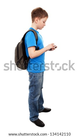 Schoolboy sending message from phone mobile isolated on white background - stock photo
