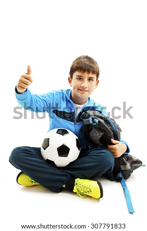 Schoolboy showing OK sign. Isolated on white background