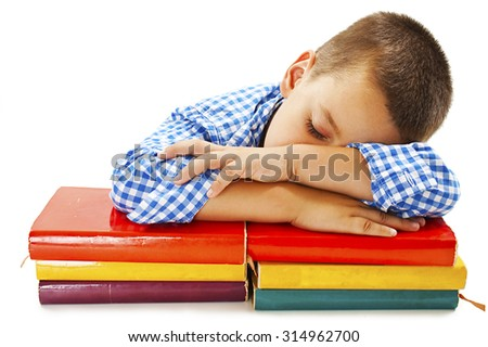 Schoolboy sleeping on school books. Isolated on white background - stock photo