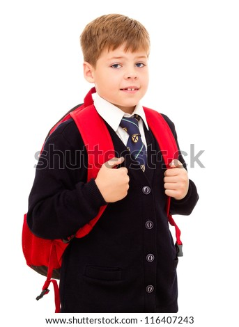 Schoolboy standing with his backpack. Wearing in school uniform. Isolated on white.