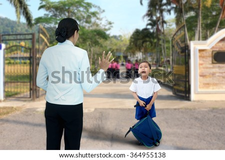 Schoolboy who crying with mother because he don't want go to school. - stock photo