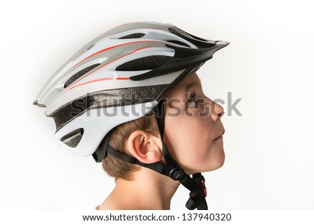 Schoolboy with a bike elmer isolated on white - stock photo
