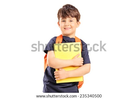 Schoolboy with backpack holding a notebook isolated against white background - stock photo