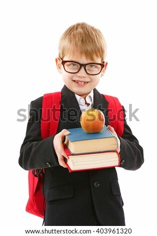 Schoolboy with backpack holding books and apple isolated on white - stock photo