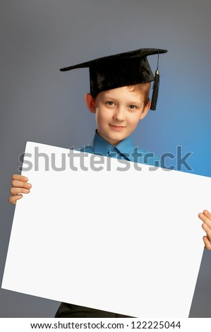 Schoolboy with blank paper - stock photo
