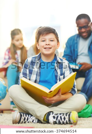 Schoolboy with book - stock photo