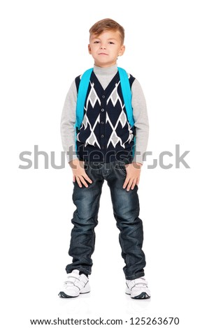 Schoolboy with hands in pockets isolated on white background