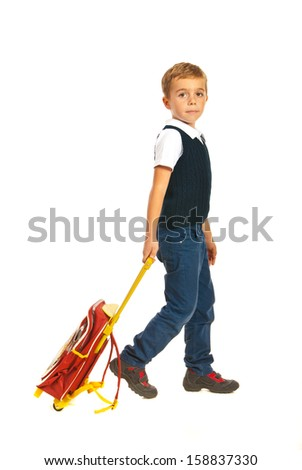 Schoolboy with schoolbag going to school isolated on white background