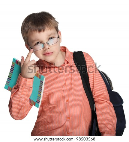 Schoolchild in glasses against white blackboard - stock photo