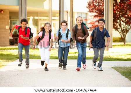 Schoolchildren at home time - stock photo