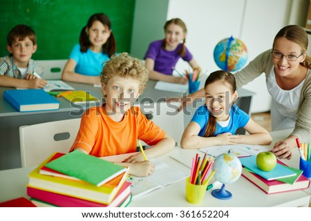 Schoolchildren at lesson - stock photo