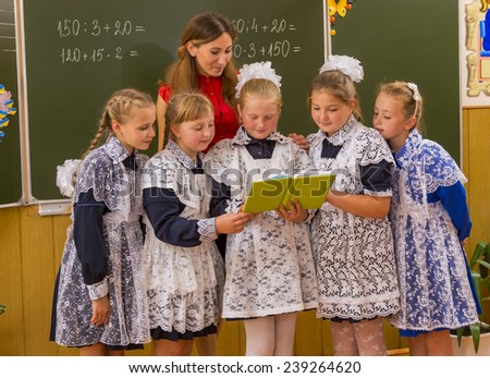 schoolchildren near the boards that you re-read - stock photo