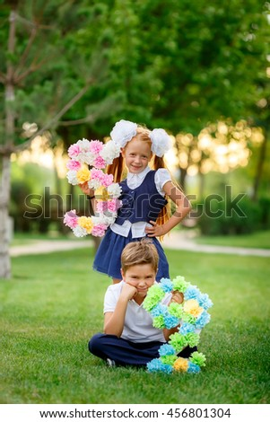 schoolchildren playing in the park after school. September 1 - stock photo