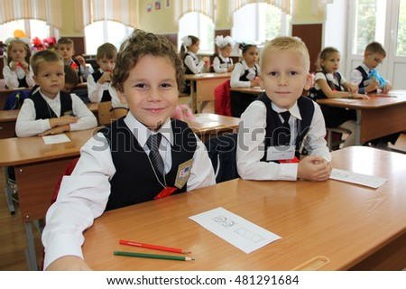 schoolchildren sit at their desks during a lesson at classroom in school - Russia Moscow the first High School the first class b - September 1 2016