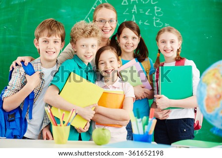 Schoolchildren with teacher - stock photo