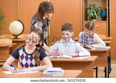 Schoolchildren work at lesson - stock photo