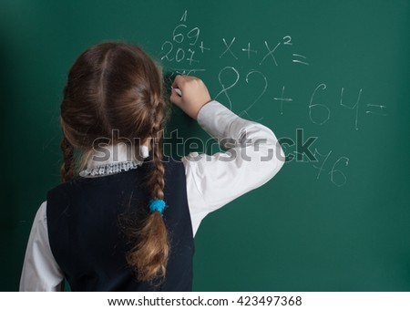 schoolgirl and school board - stock photo