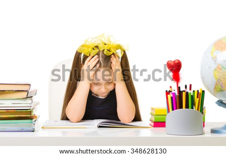 Schoolgirl at the table isolated