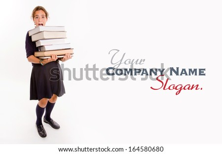 Schoolgirl carrying a heavy pile of books - stock photo